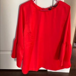 Beautiful bright red blouse with bell sleeves
